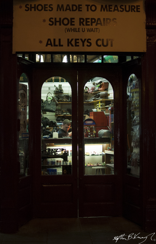 A shoe repair shop in the evening time on Talbot Street, Dublin. 16th December2013