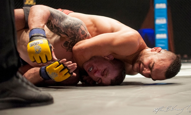 Stevie Ray, left, in the headlock from which he submitted costing him the CWFC lightweight title to Ivan Buchinger. Cagewarriors 63, The Helix, DCU. 31st December 2013