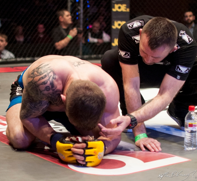 Stevie Ray reacts after losing the CWFC lightweight title to Ivan Buchinger. Cagewarriors 63, The Helix, DCU. 31st December 2013