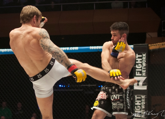 John Maguire, right, fighting Philip Mulpeter. Cagewarriors 63, The Helix, DCU. 31st December 2013