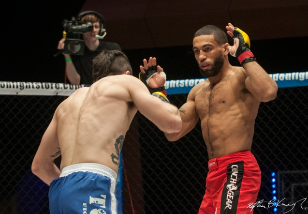 Jim Alers, right, fighting Graham Turner for the CWFC featherweight title. Cagewarriors 63, The Helix, DCU. 31st December 2013