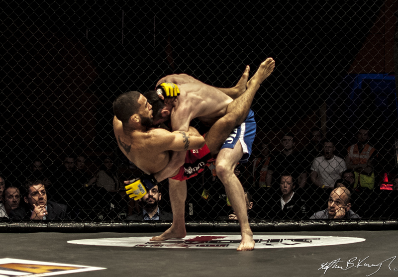 Jim Alers, bottom, fighting Graham Turner for the CWFC featherweight title. Cagewarriors 63, The Helix, DCU. 31st December 2013