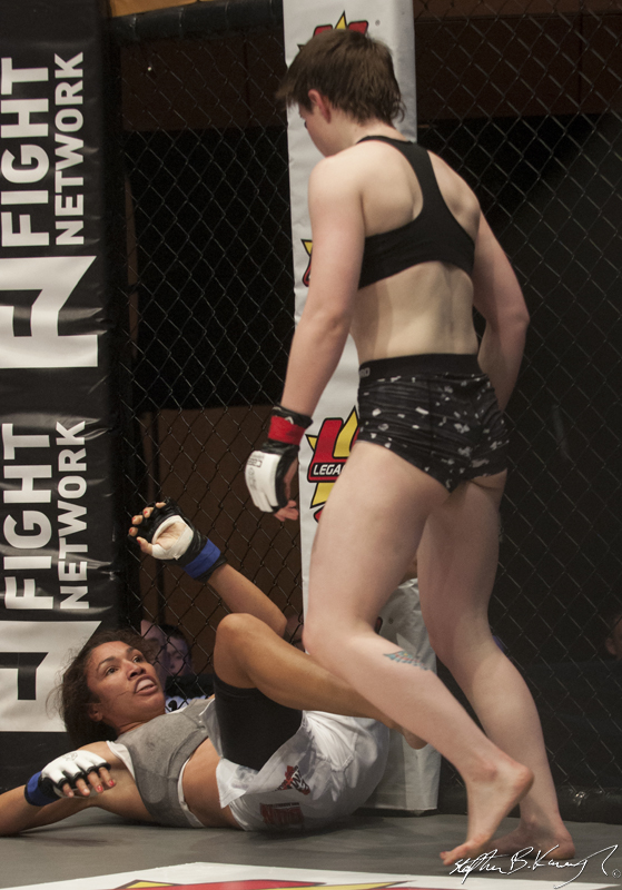 Aisling Daly, right, fighting Karla Benitez. Cagewarriors 63, The Helix, DCU. 31st December 2013