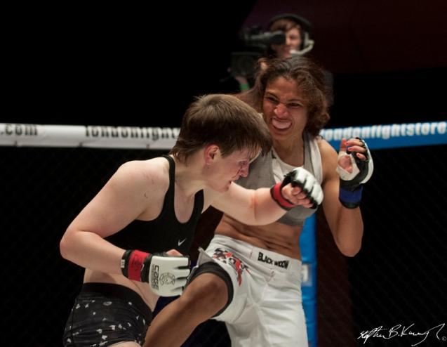 Aisling Daly, left, fighting Karla Benitez. Cagewarriors 63, The Helix, DCU. 31st December 2013