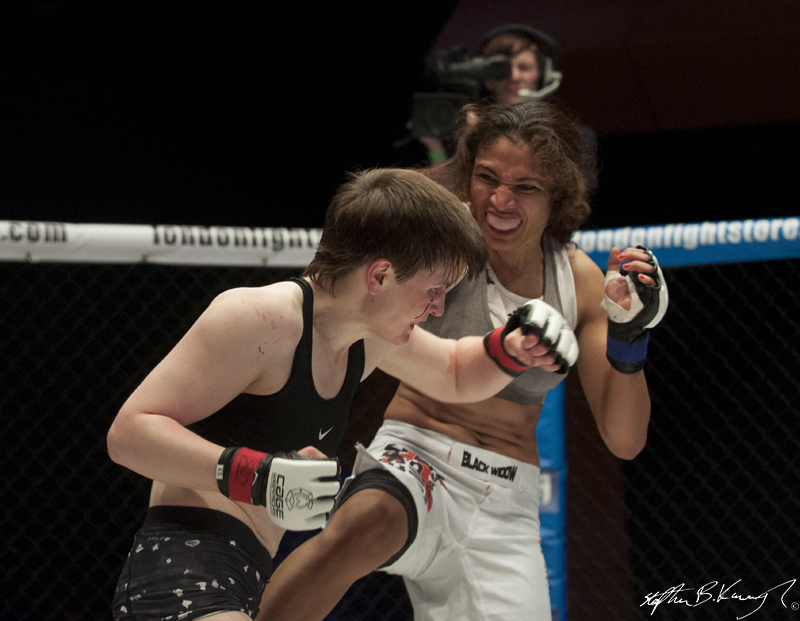 Aisling Daly, left, fighting Karla Benitez. Cagewarriors 63, The Helix, DCU. 31st December 2013