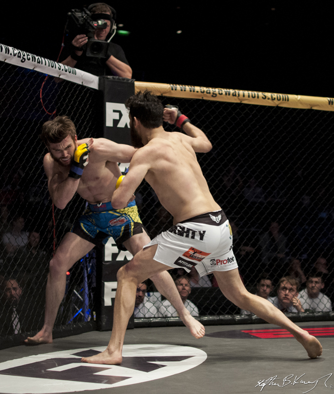 Sean Carter, right, fighting Myles Price. Cagewarriors 63, The Helix, DCU. 31st December 2013