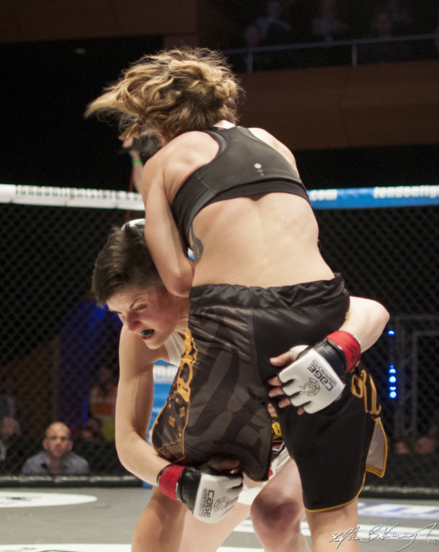 Catherine Costigan, hidden, fighting Morgane Delagnau. Cagewarriors 63, The Helix, DCU. 31st December 2013