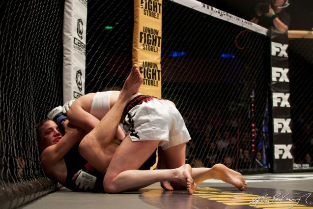 Catherine Costigan, top, fighting Morgane Delagnau. Cagewarriors 63, The Helix, DCU. 31st December 2013