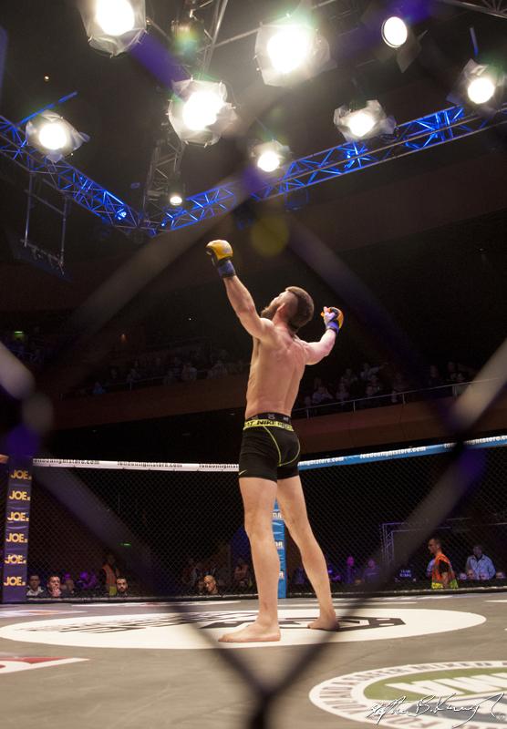 John Redmond celebrates winning his fight against Kieran Davern. Cagewarriors 63, The Helix, DCU. 31st December 2013