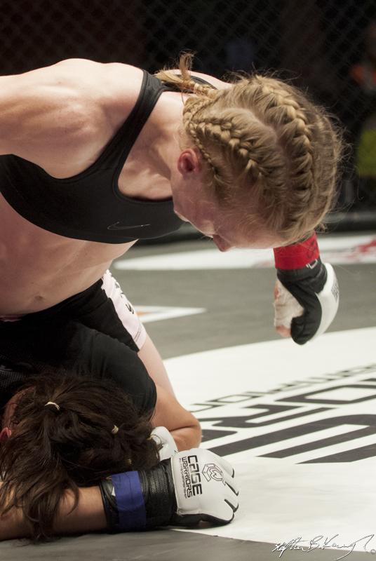 Amanda English, top, fighting Slavka Vitaly. Cagewarriors 63, The Helix, DCU. 31st December 2013