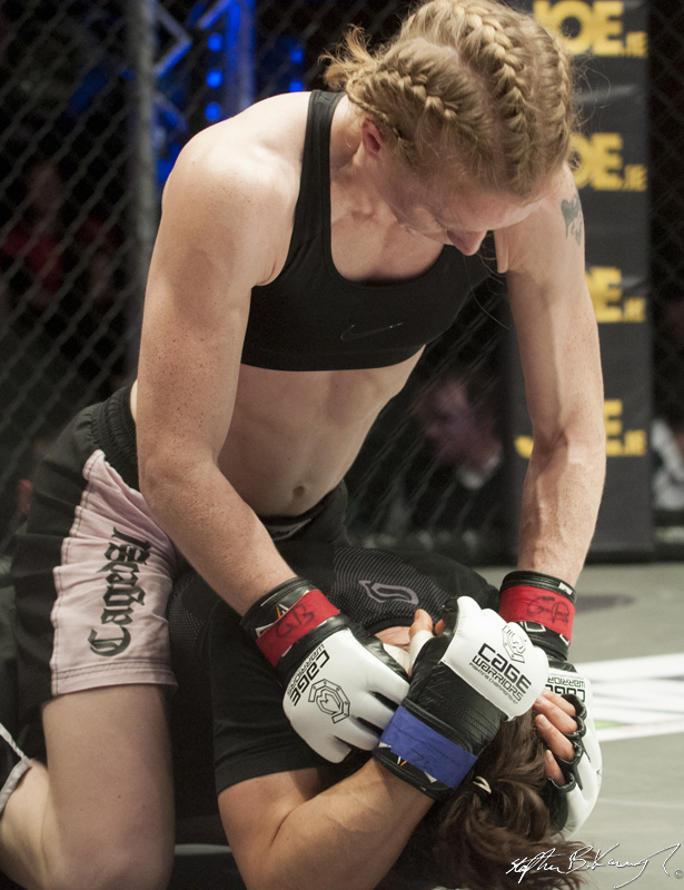 Amanda English, top, fighting Slavka Vitaly. Cagewarriors 63, The Helix, DCU. 31st December 2013