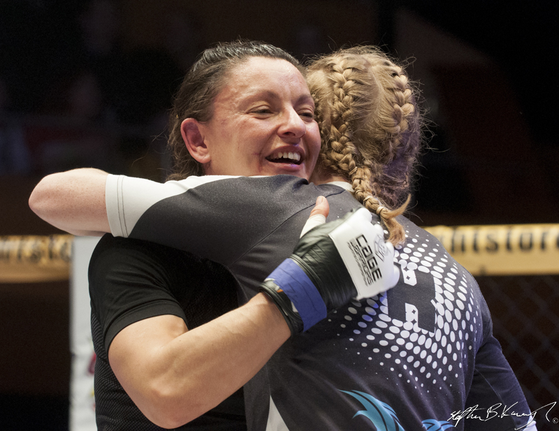 Amanda English, right, celebrates after winning her fight with Slavka Vitaly. Cagewarriors 63, The Helix, DCU. 31st December 2013