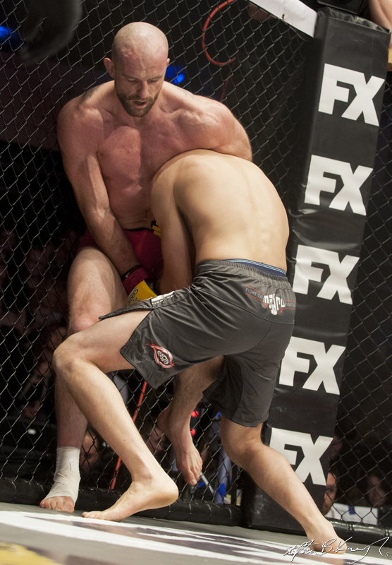 Chris Boujard, right, fighting Peter Queally. Cagewarriors 63, The Helix, DCU. 31st December 2013