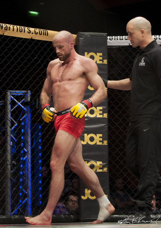 Peter Queally between rounds in his fight with Chris Boujard. Cagewarriors 63, The Helix, DCU. 31st December 2013
