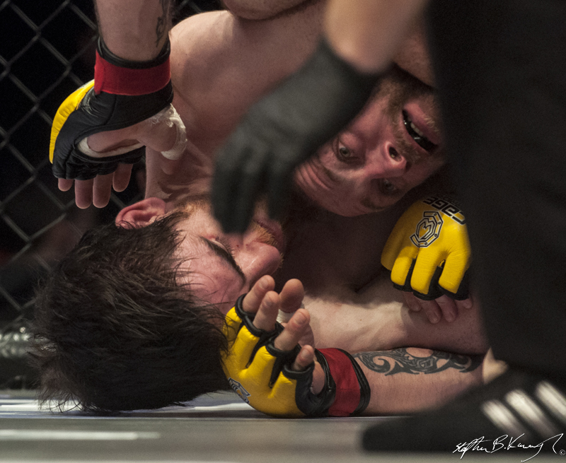 Gavin Kelly, left, fighting Dylan Sheehan. Cagewarriors 63, The Helix, DCU. 31st December 2013
