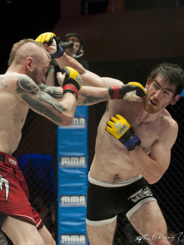 Gavin Kelly, right, fighting Dylan Sheehan. Cagewarriors 63, The Helix, DCU. 31st December 2013