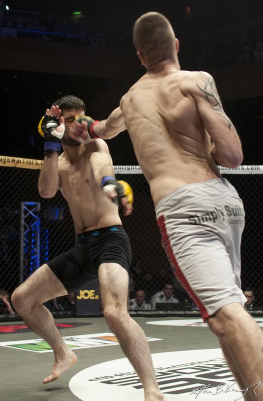 Kieran O'Brien, right, fighting Mick Brennan. Cagewarriors 63, The Helix, DCU. 31st December 2013