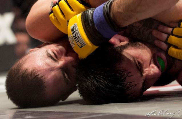 Kieran O'Brien, left, fighting Mick Brennan. Cagewarriors 63, The Helix, DCU. 31st December 2013