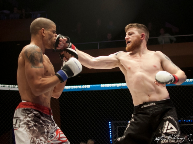 Ayo Daly, left, fighting Keith McCabe. Cagewarriors 63, The Helix, DCU. 31st December 2013