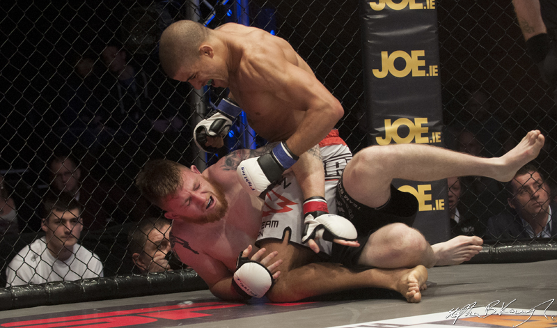 Ayo Daly, top, fighting Keith McCabe. Cagewarriors 63, The Helix, DCU. 31st December 2013