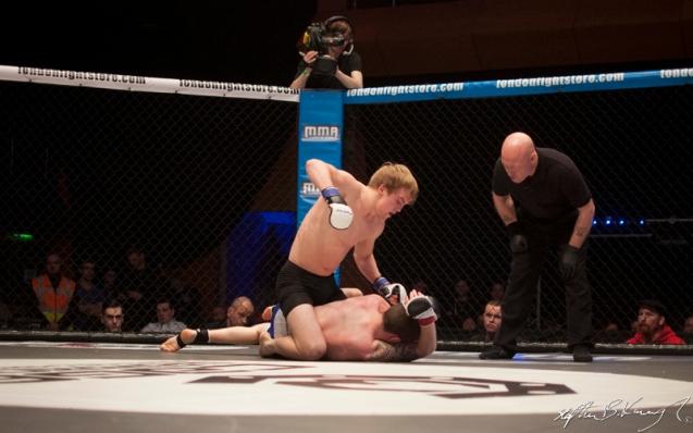 Adam Caffrey, top, fighting Kyle Comerford. Cagewarriors 63, The Helix, DCU. 31st December 2013