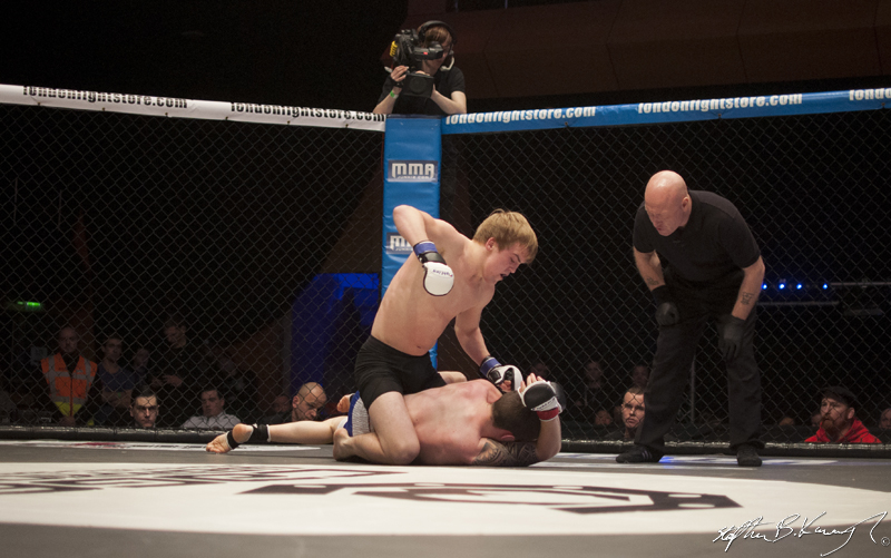 Adam Caffrey, top, fighting Kyle Comerford. Cagewarriors 63, The Helix, DCU. 31st December 2013