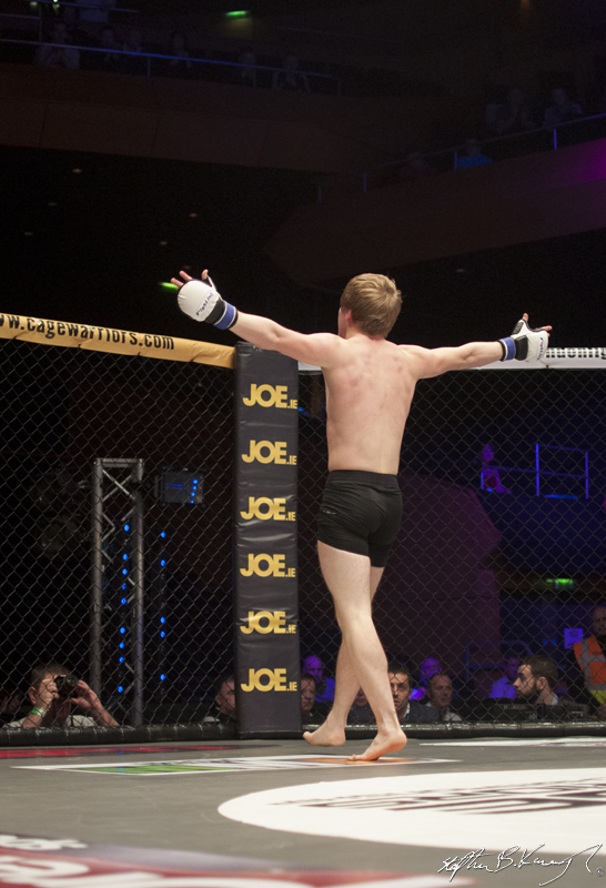 Adam Caffrey celebrates after winning his fight against Kyle Comerford. Cagewarriors 63, The Helix, DCU. 31st December 2013