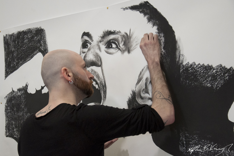 Barry Jazz Finnegan draws a mural of Conor McGregor at the opening of the new Straight Blast Gym branch on the Naas Road, Dublin. 11th January 2014