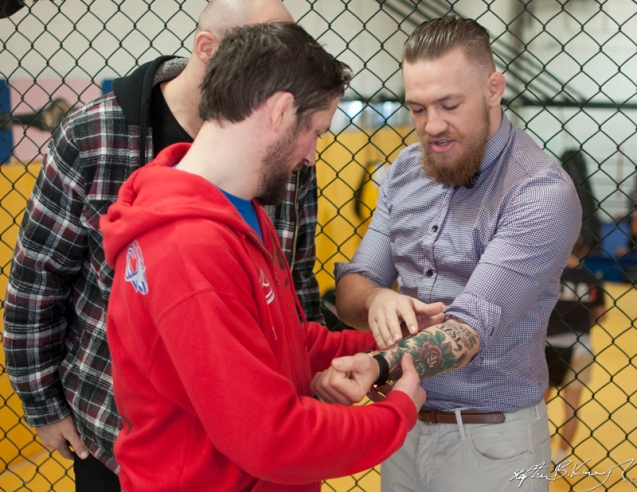 Conor McGregor, right, shows his tattoos to John Kavanagh at the opening of the new Straight Blast Gym branch on the Naas Road, Dublin. 11th January 2014