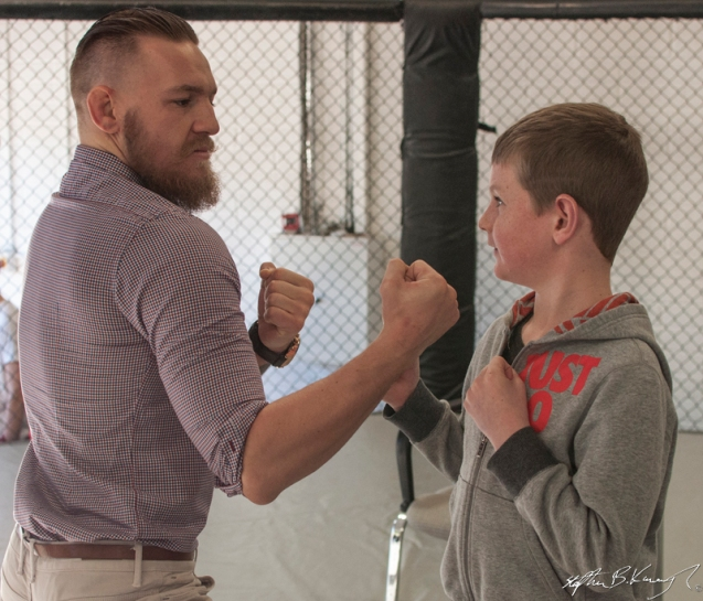 Conor McGregor with a young fan at the opening of the new Straight Blast Gym branch on the Naas Road, Dublin. 11th January 2014