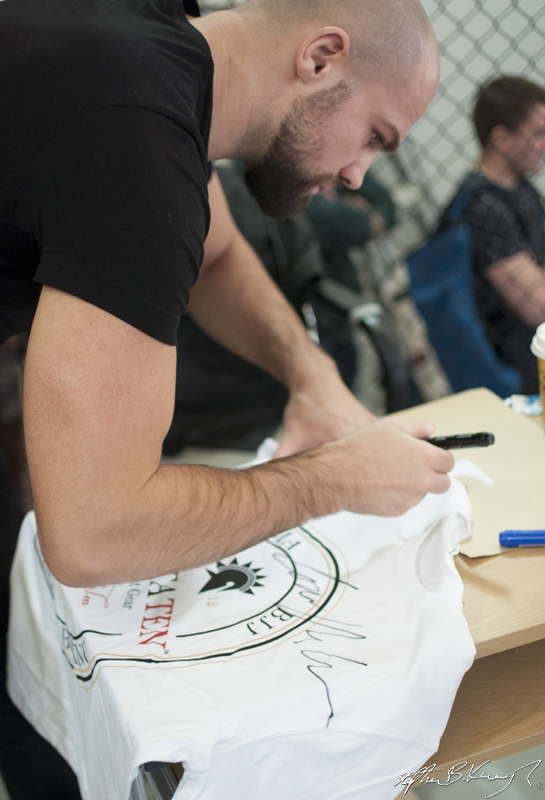 Cathal Pendred signs the Spatraten T-Shirt of Stephen Meagher at the opening of the new Straight Blast Gym branch on the Naas Road, Dublin. 11th January 2014