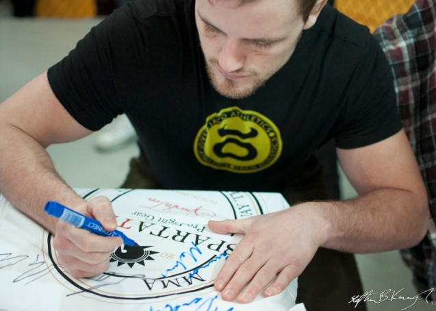 Gunnar Nelson signs the Spatraten T-Shirt of Stephen Meagher at the opening of the new Straight Blast Gym branch on the Naas Road, Dublin. 11th January 2014