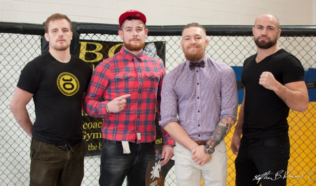 A fan meets Gunnar Nelson, left, Conor McGregor and Cathal Pendred at the opening of the new Straight Blast Gym branch on the Naas Road, Dublin. 11th January 2014