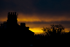 The sun sets over the rooftops of the houses on Leinster Road, Dublin. 3rd February 2014