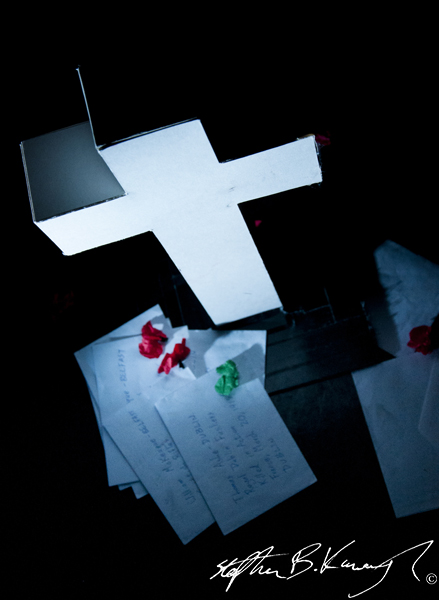 A cross and some letters to the families of dead soldiers. Poppies and shamrocks represent the men who died in World War I and the 1916 Rising during showings of The Rising and by way of Interludes World War I in The Powerscourt Theater, Dublin. 11th March 2014