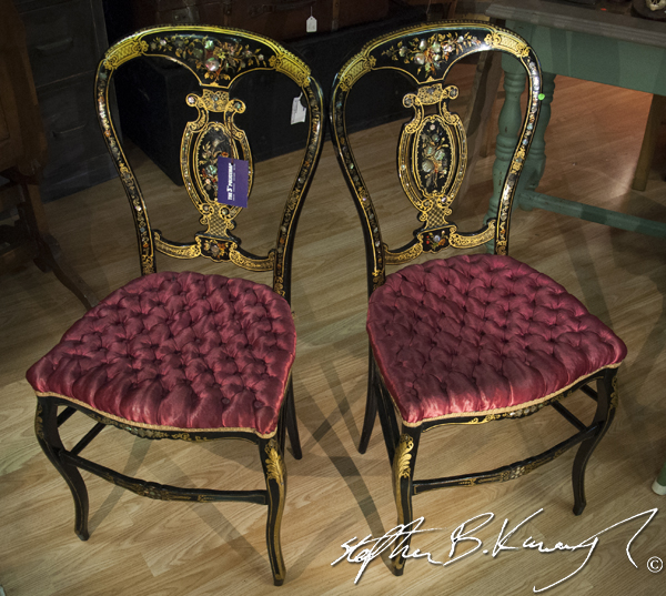 A pair of intricately painted and upholstered chairs in the 3rd Policeman antique shop, Rathmines, Dublin, Ireland. 20th May 2014