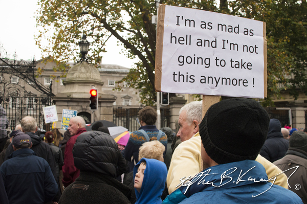 A protestor holds up a sign during the march against the incoming water charges in the Republic of Ireland. Dublin. 1st November 2014