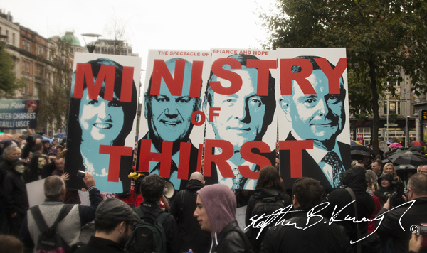 Protestors hold up signs during the march against the incoming water charges in the Republic of Ireland. O'Connell Street, Dublin. 1st November 2014