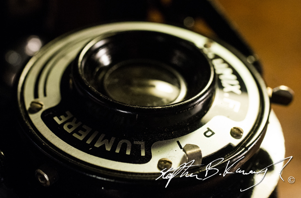The lens of a Lumière Lumix-F camera from 1949 in perfect condition. The 3rd Policeman, Rathmines, Dublin, Ireland. 10th February 2015. Picture Credit: Stephen B.K.