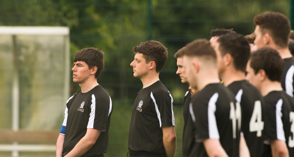 OSG , black and white, stand for a minutes silence in respect for the six students who died when a balcony collapsed in Berkeley, USA ahead of the DIAS 2015 Mes's 11 a Side Tournament Final. Irishtown Stadium, Ringsend, Dublin, Ireland. 19th June 2015. Picture Credit: Stephen B.K.