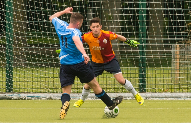 Goalkeeper Trevor Dunne, OSG , saves a shot on goal by AIG. DIAS 2015 Mes's 11 a Side Tournament Final. Irishtown Stadium, Ringsend, Dublin, Ireland. 19th June 2015. Picture Credit: Stephen B.K.