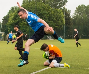 Goalkeeper Trevor Dunne, OSG ,slides in to save a shot on goal by AIG. DIAS 2015 Mes's 11 a Side Tournament Final. Irishtown Stadium, Ringsend, Dublin, Ireland. 19th June 2015. Picture Credit: Stephen B.K.