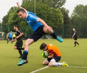 Goalkeeper Trevor Dunne, OSG ,slides in to save a shot on goal by AIG. DIAS 2015 Mes's 11 a Side Tournament Final. Irishtown Stadium, Ringsend, Dublin, Ireland. 19th June 2015. Picture Credit: Stephen B.K.