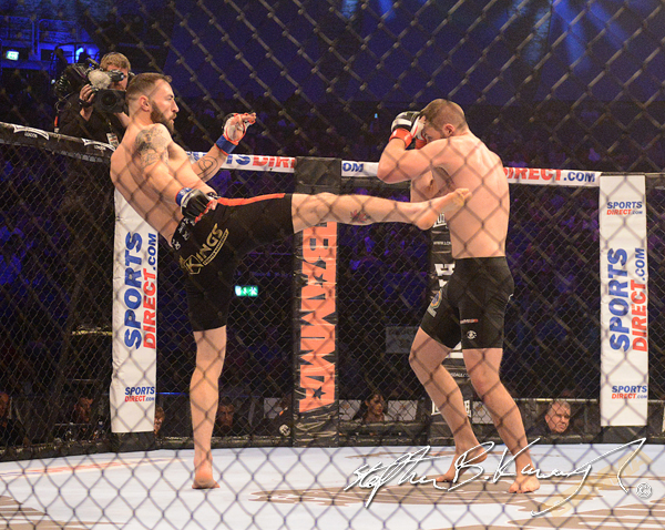 19 February 2015; Paul Craig, left, in action against Karl Moore during their Light Heavyweight bout. BAMMA 22. 3 Arena, North Wall Quay, Dublin. Picture credit: Stephen B.K. / SPORTSFILE