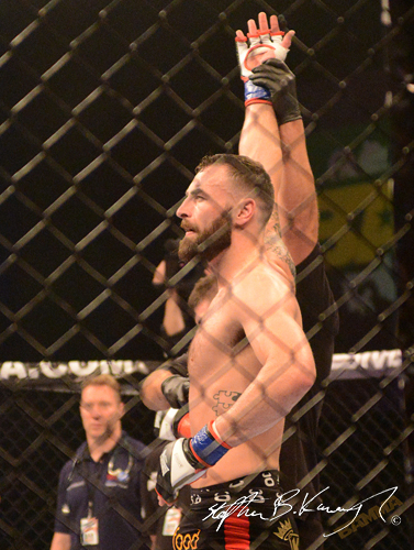 19 February 2015; Paul Craig celebrates after winning his Light Heavyweight bout against Karl Moore. BAMMA 22. 3 Arena, North Wall Quay, Dublin. Picture credit: Stephen B.K.