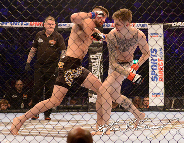 19 February 2015; John Redmond, left, in action against Rhys McKee during their Welterweight bout. BAMMA 22. 3 Arena, North Wall Quay, Dublin. Picture credit: Stephen B.K.