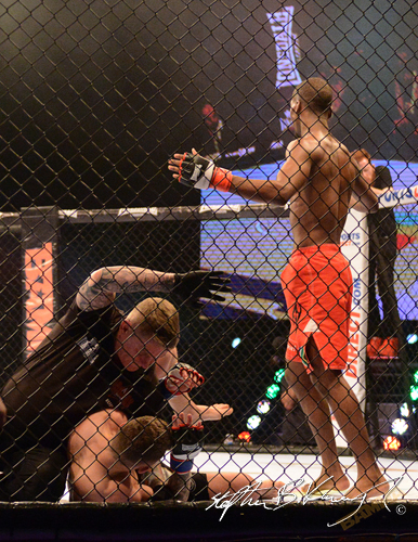 19 February 2015; Frans Mlambo, right, after knocking out Darren O'Gorman. BAMMA 22. 3 Arena, North Wall Quay, Dublin. Picture credit: Stephen B.K.