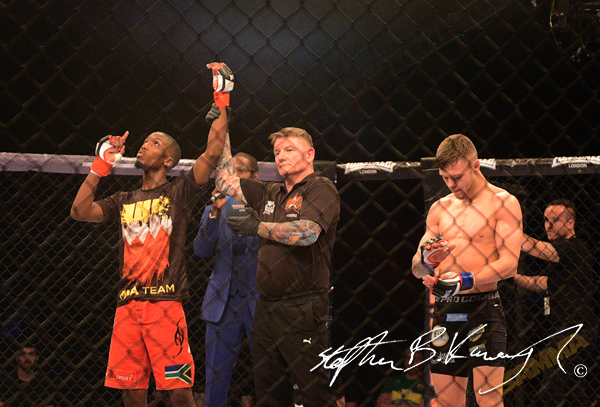 19 February 2015; Frans Mlambo, left, celebrates victory after knocking out Darren O'Gorman, right. BAMMA 22. 3 Arena, North Wall Quay, Dublin. Picture credit: Stephen B.K.