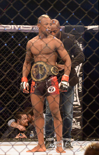 19 February 2015; Marc Diakiese celebrates after winning his bout against Rick Selvarajah by knockout. BAMMA 22. 3 Arena, North Wall Quay, Dublin. Picture credit: Stephen B.K.
